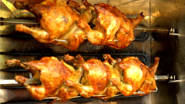 Chickens in a rotisserie. video