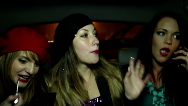 Chicks talking, laughing and making a selfie in the back of a cab video