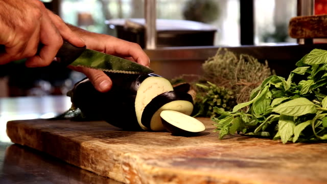 Chief cut an eggplant. video