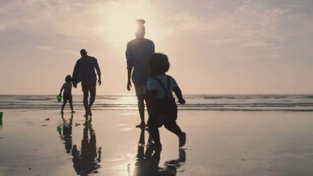 A child adds joy to every day 4k video footage of an attractive young woman bonding with her son during an enjoyable day out on the beach family stock videos & royalty-free footage