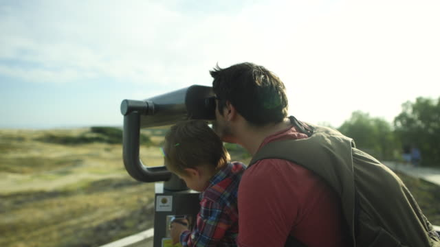 Child and father enjoying nature, tourism concept