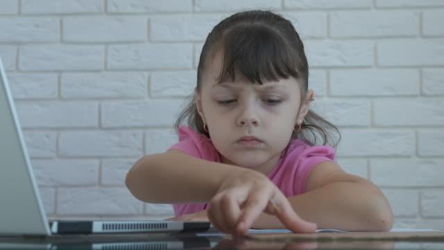 child asked for help on cardboard. - wschodnio europejski filmów i materiałów b-roll