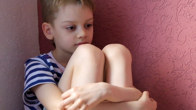 Child boring Bored boy sitting at home in corner of room one boy only stock videos & royalty-free footage