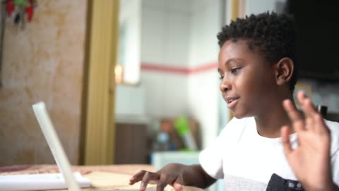 Child boy studying with laptop on a online class at home Child boy studying with laptop on a online class at home child stock videos & royalty-free footage