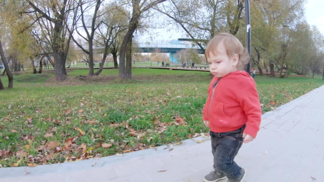 Child boy walks with mom video