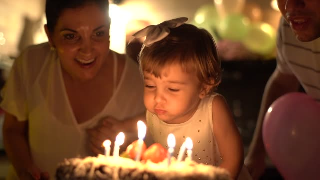 child celebrating her birthday party at home - happy family стоковые видео и кадры b-roll