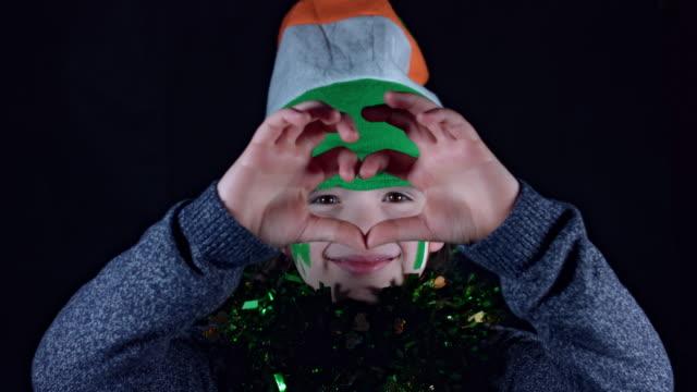 4K Child Celebrating St. Patrick's Day Showing Love video
