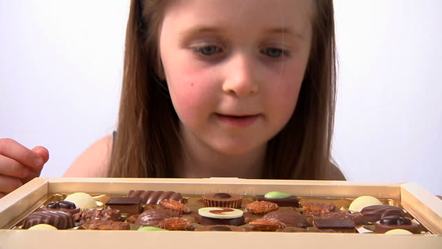 Child choosing a chocolate video