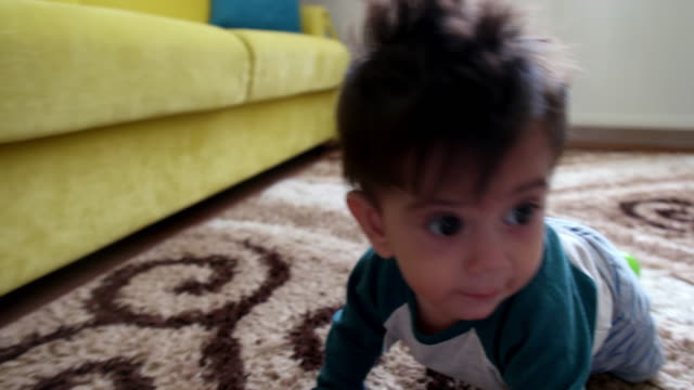 Child crawling on the carpet video