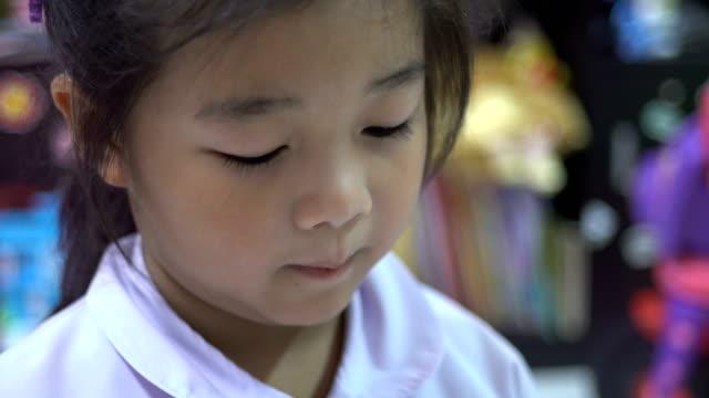 Child cutting paper video