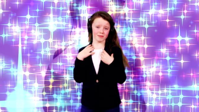Child dancing with headphones video
