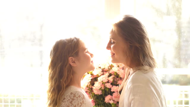 Child daughter congratulates moms and gives her a gift box. Happy mother's day Child daughter congratulates moms and gives her a gift box. Happy mother's day 4k mothers day stock videos & royalty-free footage