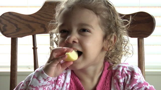 Child Eating Apple Slices video