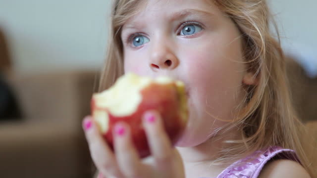 Child eating apple video