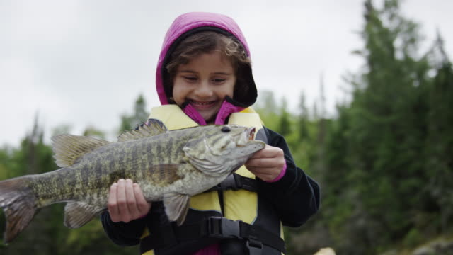 Child fishing for bass video