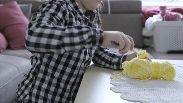 Child girl  knitting