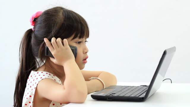Child girl talking mobile phone. video
