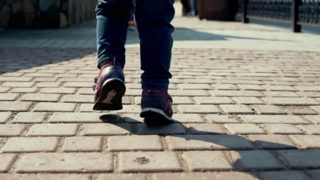 Child Girl Toddler Legs In Jeans On Street Pavement During Family Walking video