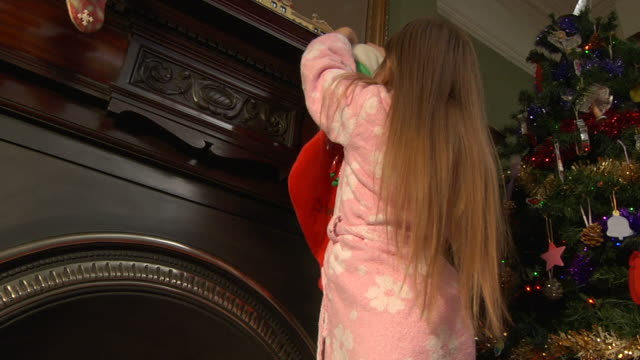 Child hanging Christmas stocking video
