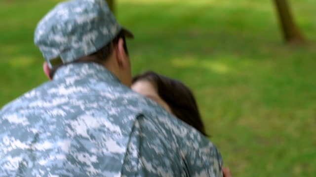 Child hugging military father, long-awaited meeting after peacekeeping mission Child hugging military father, long-awaited meeting after peacekeeping mission family 4th of july stock videos & royalty-free footage