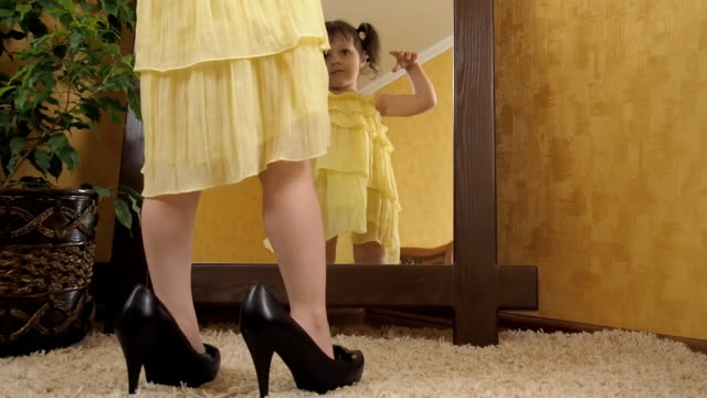 A child in shoes for adults