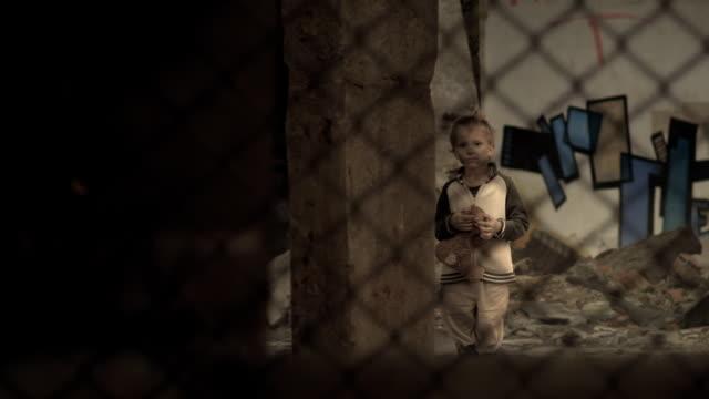Child in slums. Orphans. Refugee camp. video