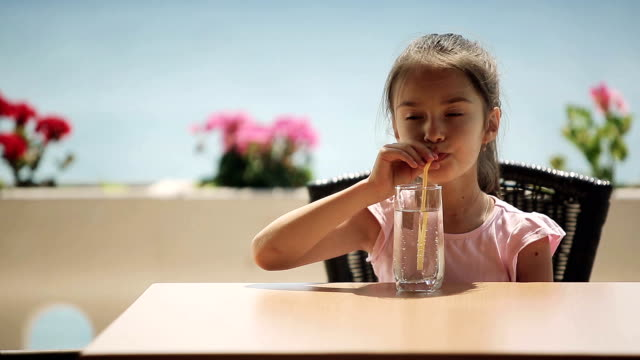 Child is drinking water in the restaurant video