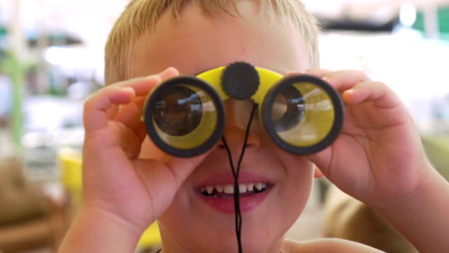 Child looking through the binoculars video