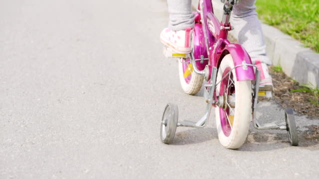 Child on a bicycle at asphalt road video