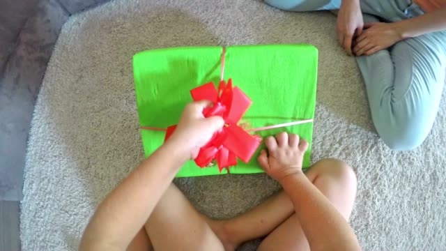 POV Child opening a birthday present video