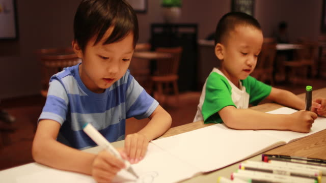 Child painting and writing
