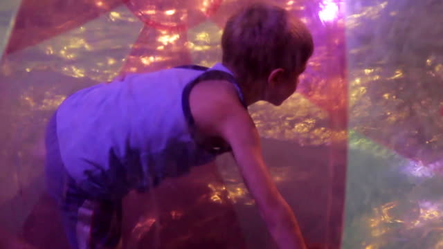 child playing in the water park on the water, HD 1080p video