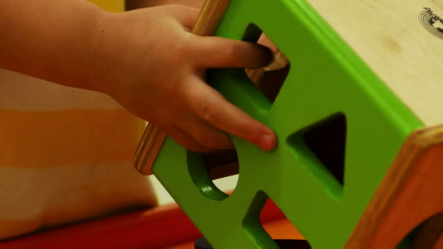 Child playing toy , close up