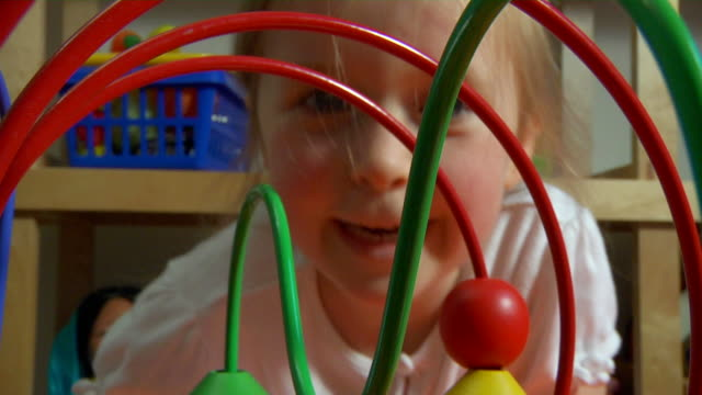 Child playing with toy video