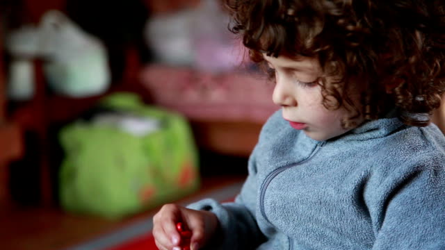 Child playing with toys in the bedroom video