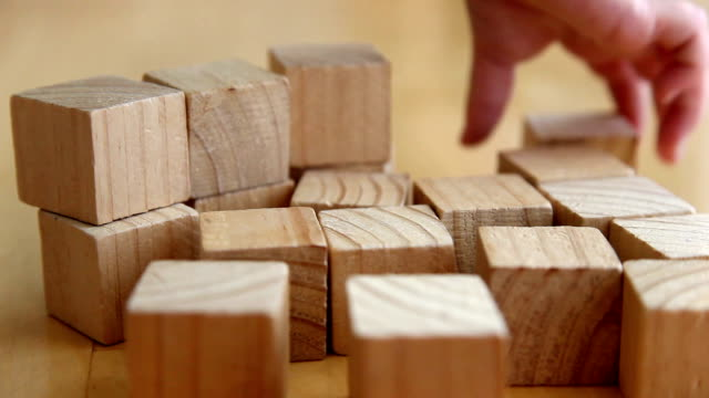 child playing with wooden blocks (full hd) - lego stok videoları ve detay görüntü çekimi