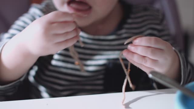 Child plays with food video