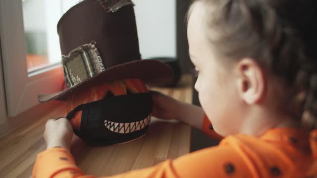 Child preparing for Halloween