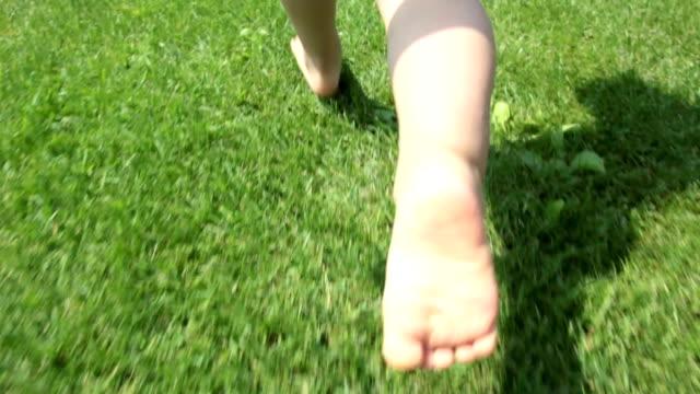 Child running in the garden video