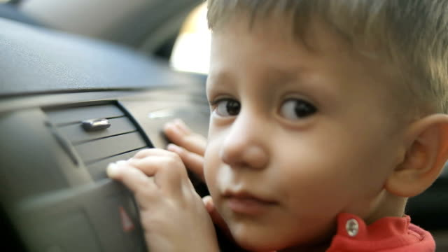 child sitting in the front seat of the car video