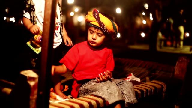 Child sitting on charpai video