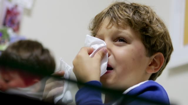 Child sniffing nose with handkerchief. Handsome young boy recovering from the flu in 4K Child sniffing nose with handkerchief. Handsome young boy recovering from the flu in 4K flu stock videos & royalty-free footage