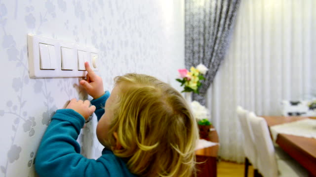 DOLLY: Child switching off a light switch Child switching off a light switch. start button stock videos & royalty-free footage