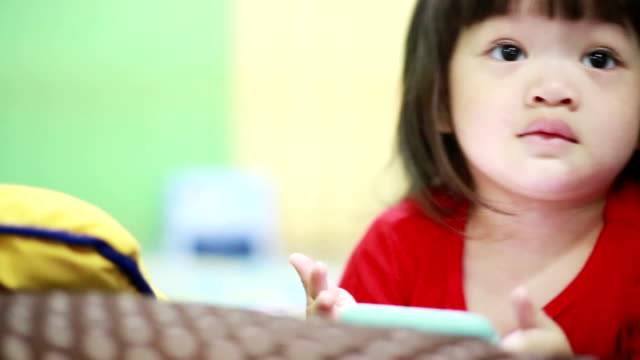 Child using smart phone at home video