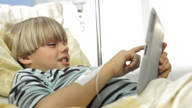 HD: Child Using Tablet In The Hospital video