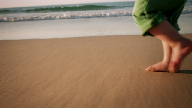 Child walking on beach video