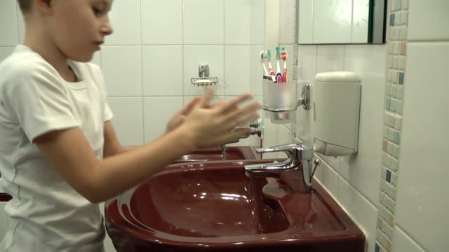 child washes with soap video
