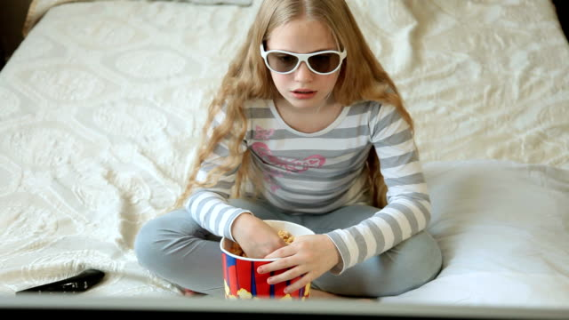 Child Watching 3D TV Movie at Home video