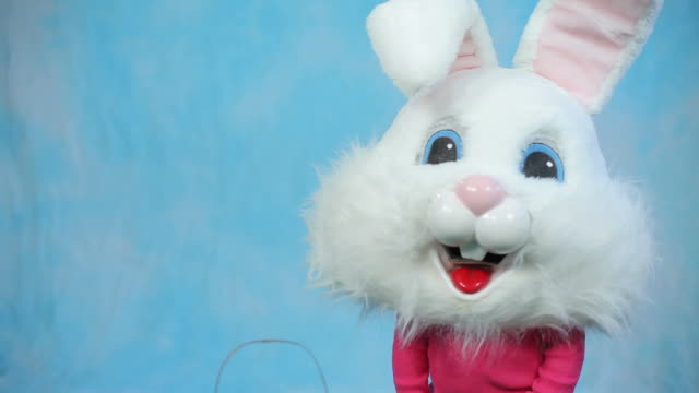 Child wearing Easter bunny head video