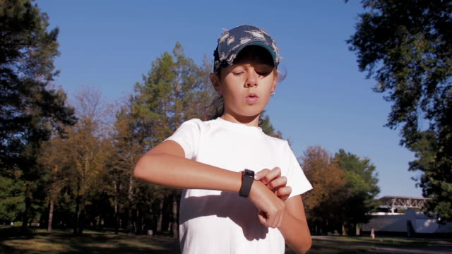 A child with a sports gadget. A child with a sports gadget. A little girl runs with a sports gadget. panting stock videos & royalty-free footage